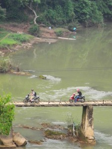 Crossing a bridge in Vietnam