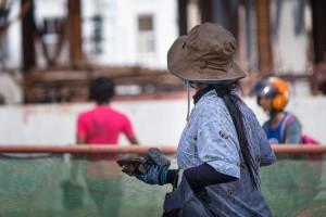 Protester carrrying rocks, Phnom Penh cambodia