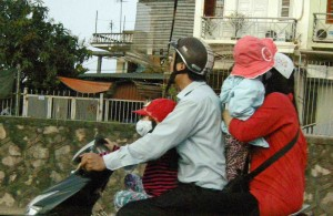 The driver, alone, needs a helmet in Vietnam