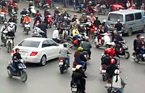Roundabout with scooters in Hanoi, Vietnam