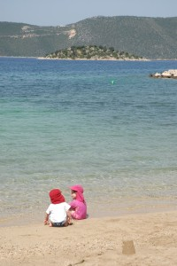 Children on beach in protective clothes
