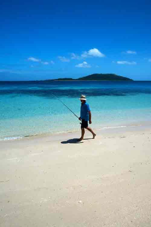 Yasawa Islands, Fiji, fisherman on beach