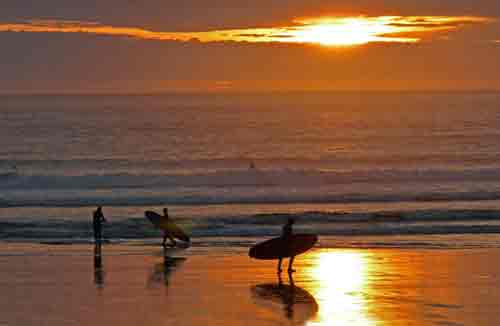 Surfers at night, Tofino, Vancouver
