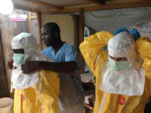 Health workers masking up against Ebola