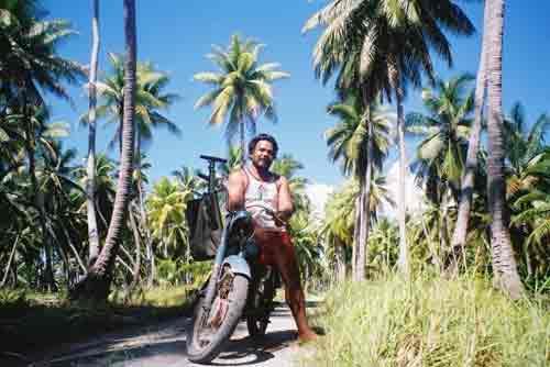 Tiare on his bike, Kiribati, tropical pacific