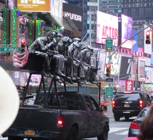 Truck carrying sculptures