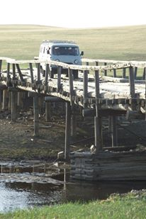 Van on bridge, Mongolia