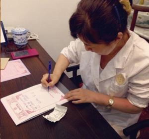 Doctor writing prescription, Beijing