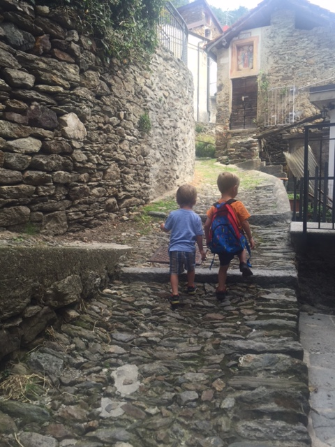 Twins on cobbled path, Lake Como