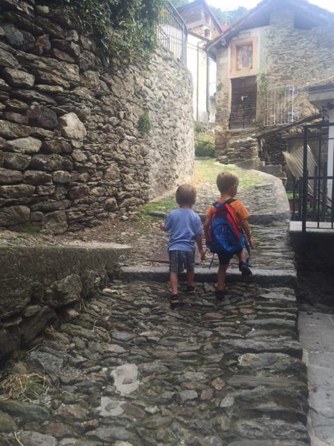 Twins on cobbled path, Lake Como