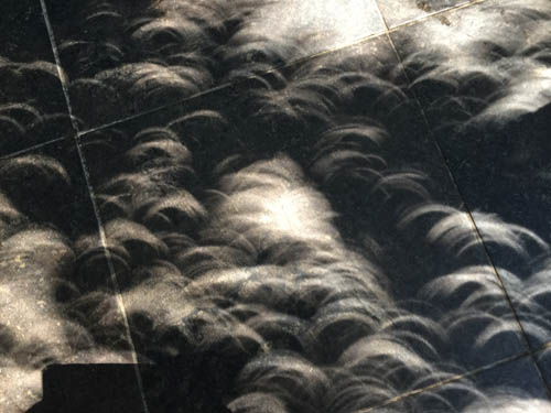 Patio patterns from the solar eclipse